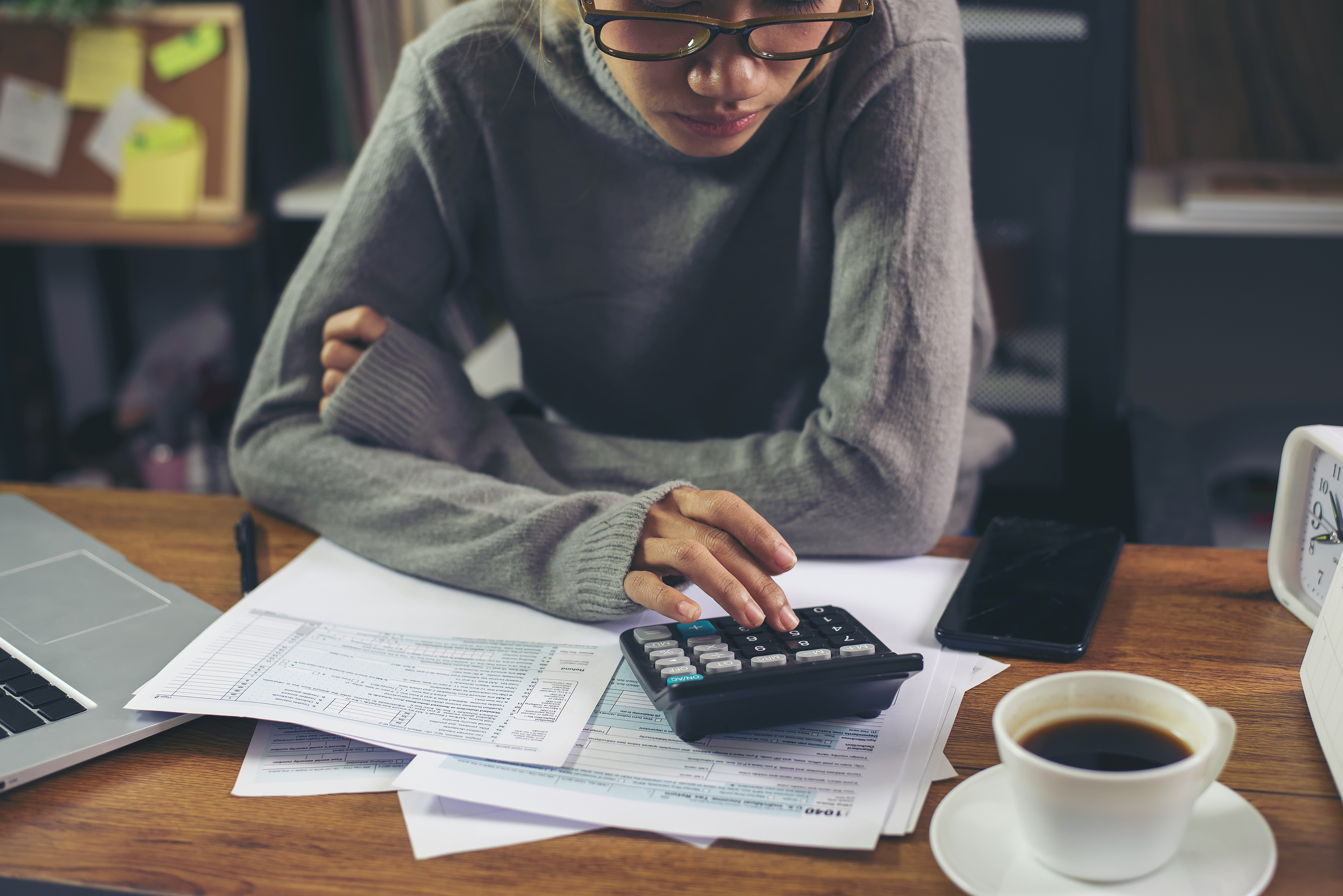Woman Calculating Taxes